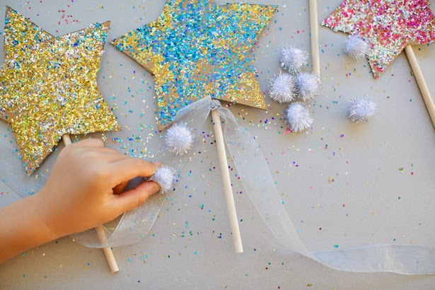 http://www.hellowonderful.co/post/DIY-GLITTER-CELEBRATION-STAR-WANDS