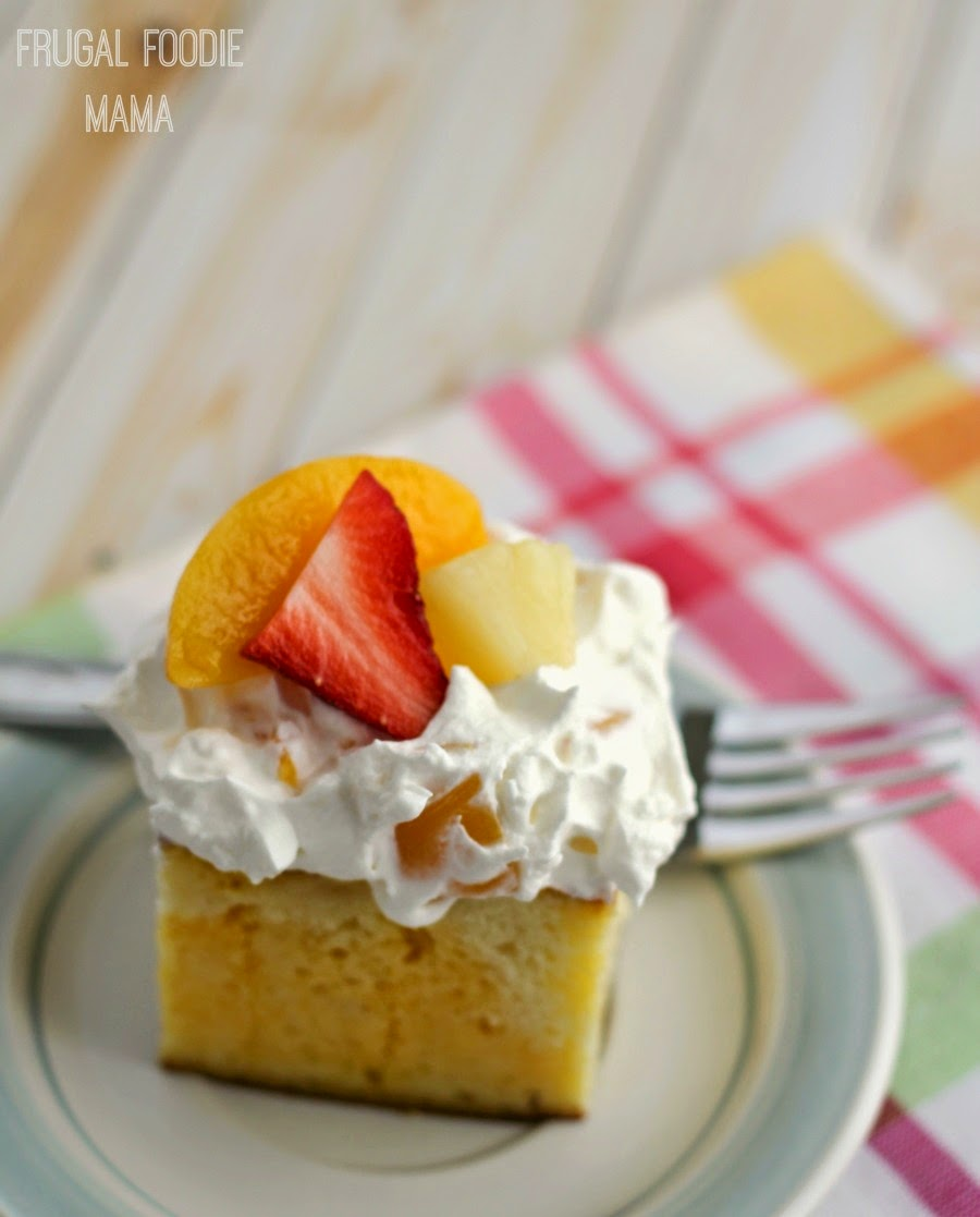 This easy to make Tropical Sangria Poke Cake is spiked with white wine mango gelatin and then topped off with a fruity whipped topping frosting.