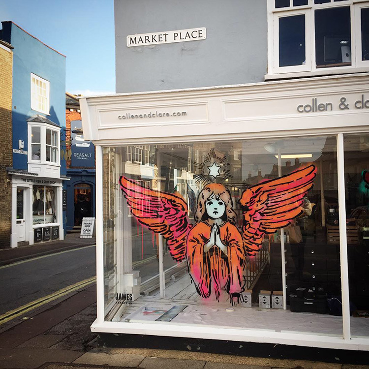 Hark - a street art installation of an angel in Southwold by artist James Straffon