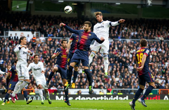 Sergio Ramos rises above Gerard Piqué to score Real Madrid's winning goal against Barcelona