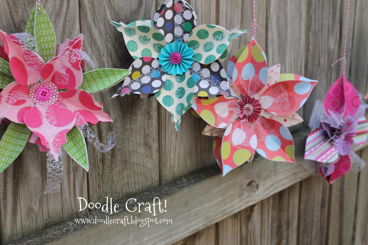 how to make 3D snowflakes or flowers using a cutting machine and bright paper.
