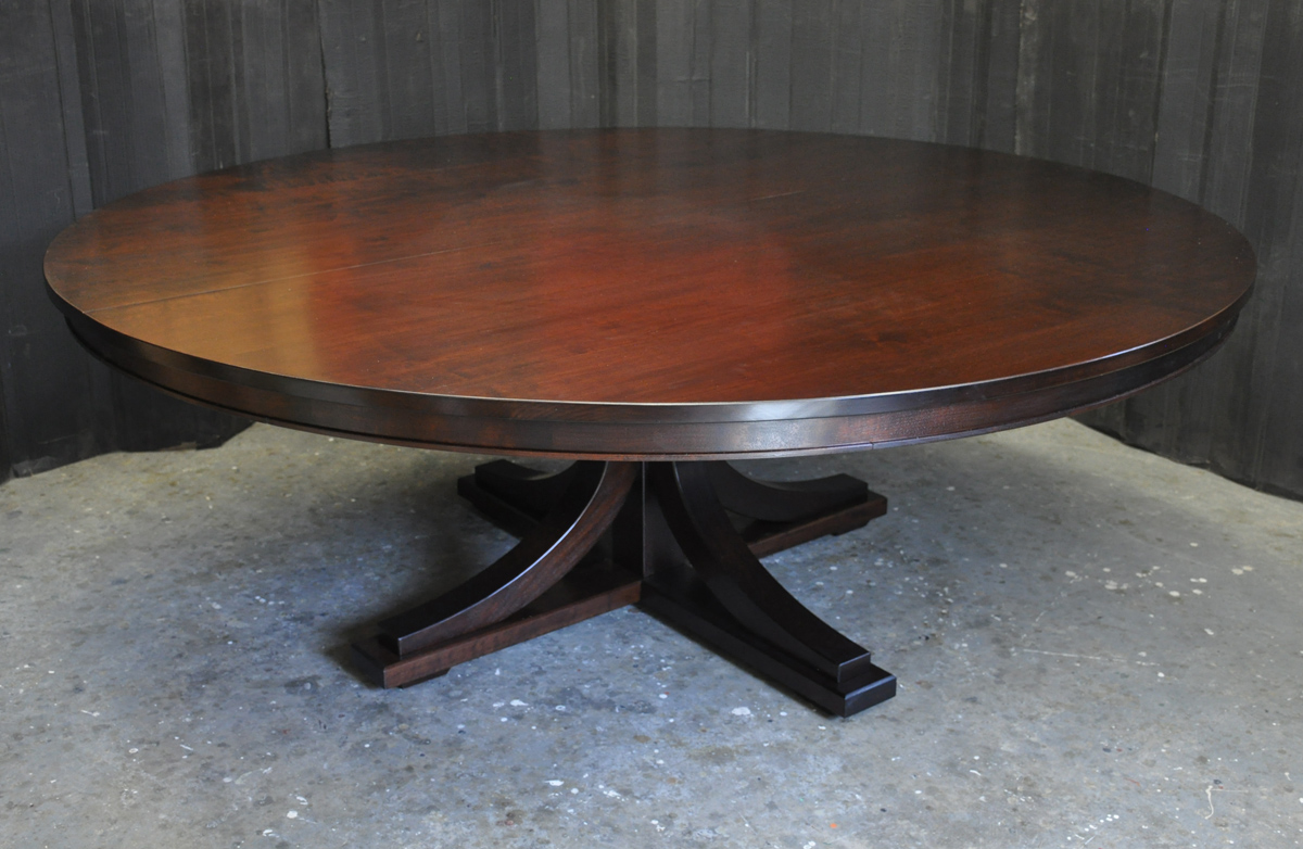An 80 Inch Round Table.. Opens To 128 Inches