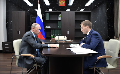 Vladimir Putin and Governor of Amur Region Alexander Kozlov.