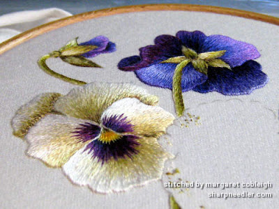 Showing the shininess of the DMC threads on some thread painted pansies. (Pansies designed by Trish Burr)