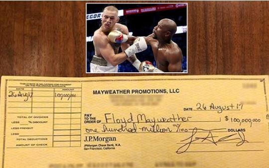 Floyd Mayweather shows off $100million cheque he earned after beating Conor McGregor