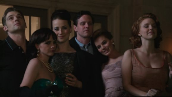 Pan Am cast - Dean ( Mike Vogel), Maggie (Christina Ricci), Colette (Karine Vanasse), Ted (Michael Mosley), Laura (Margot Robbie), Kate (Kelli Garner) stand on hotel balcony at night