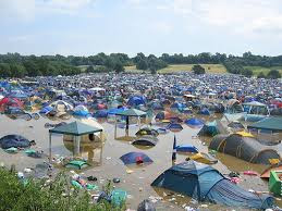 A picture of one of the camp sites of many many subsided tents under the heavy rain!