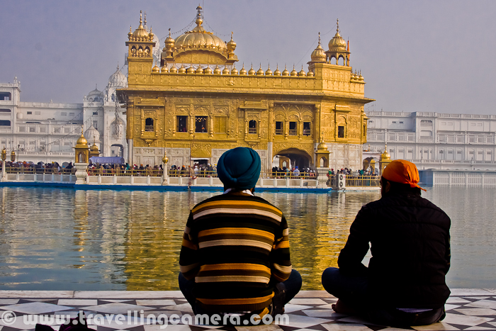 Many folks sit on Sarovar-side for peaceful prayers at Golden Temple, Amritsar. And it's a must thing to sit inside the Golden Temple once.
