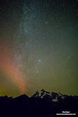 Northern Lights (Aurora Borealis) over Mount Shuksan in the North Cascades, North Cascades National Park, Washington, USA.