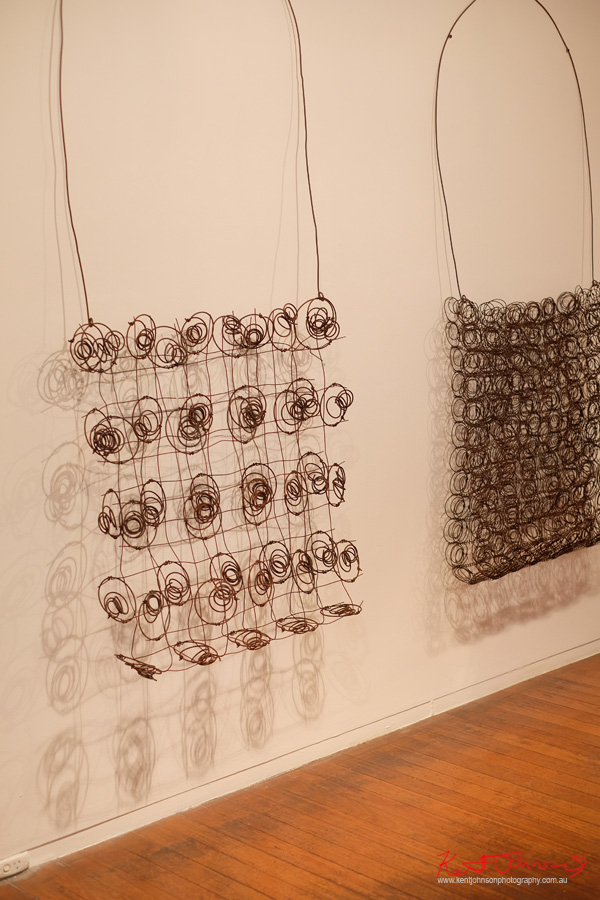 Two bags made from steel mattress springs and wire Narrbong-Galang by Lorraine Connelly-Northey - Photography by Kent Johnson for Street Fashion Sydney