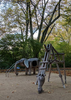 Elephant and giraffe play structures made of wood and rope, along the Sihl River, Zürich, Switzerland