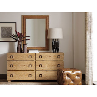 leather-framed mirror and ottoman