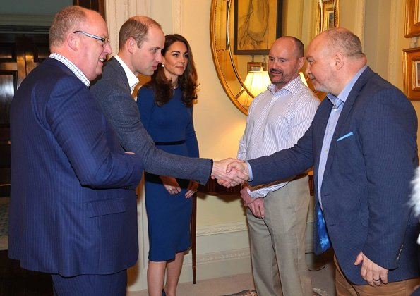 Kate Middleton wore Mulberry blue Ashleigh cape coat and a new Jenny Packham dress.The Duchess is wearing a cape coat by Mulberry