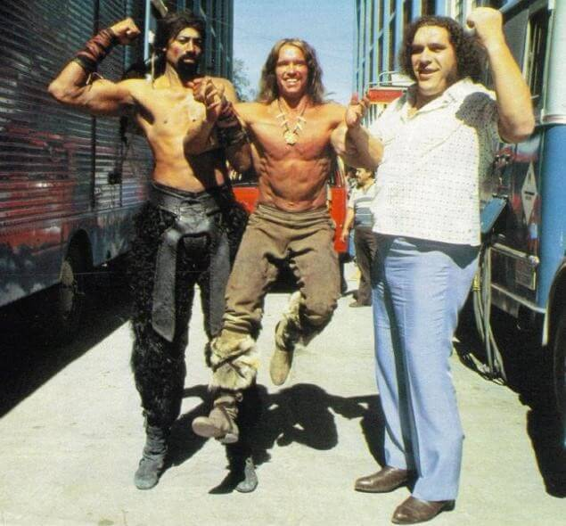 60 Iconic Behind-The-Scenes Pictures Of Actors That Underline The Difference Between Movies And Reality - The Big 3 Wilt Chamberlain, Arnold Schwarzenegger, and Andre the Giant, seen goofing around on the set of