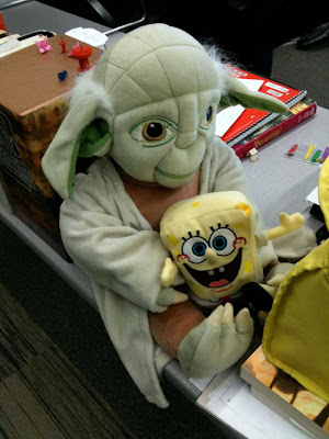 Plush Yoda doll with a smaller Spongebog doll on his lap