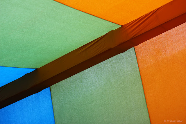 A Look up Minimal Art Photograph of Tri Colored Coloful Tents shot at Jawahar Kala Kendra Jaipur, India