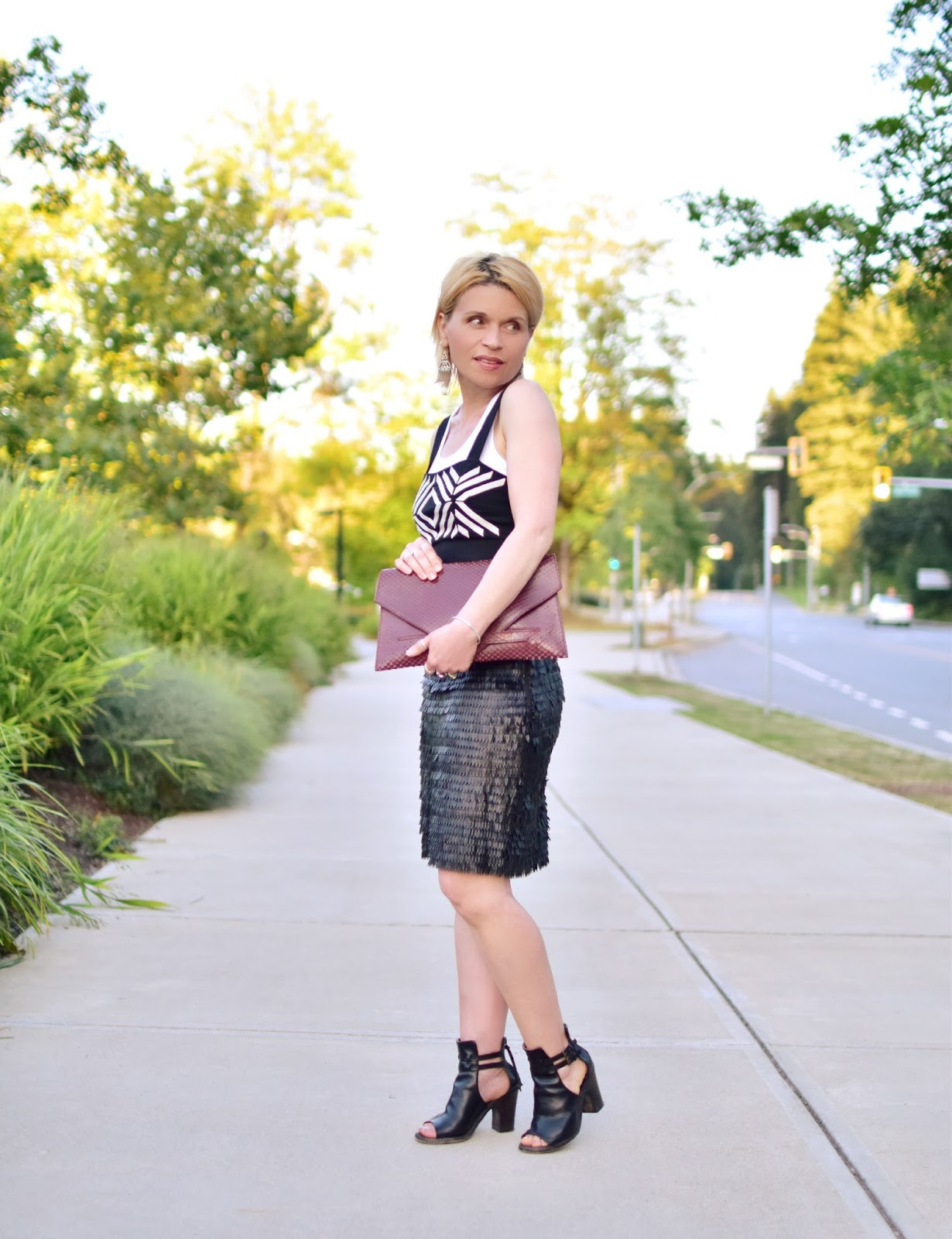 Monika Faulkner styles a textured faux-leather skirt with a boyfriend tank and graphic crop top