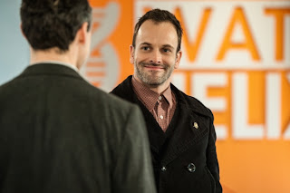 Jonny Lee Miller as Sherlock Holmes smiling in CBS Elementary Episode 17 Possibility Two