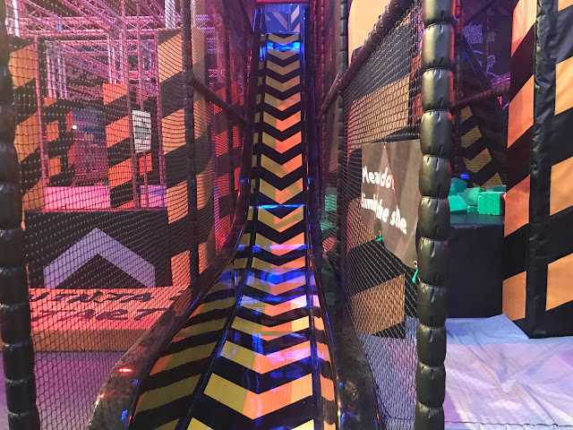 yellow and black striped indoor slide at Jump 360 Newcastle trampoline park