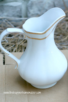 A close up of a white vase with gold accents