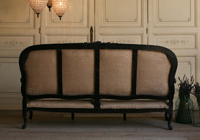 Vintage Settee Handsome and chic vintage settee with cotton canvas cushion and burlap upholstery. The Louis XV shape adds a lovely feminine hint to the black carved frame.  39H x 73W x 30D Seat Height: 18 Arm Height: 23 as seen on l&l