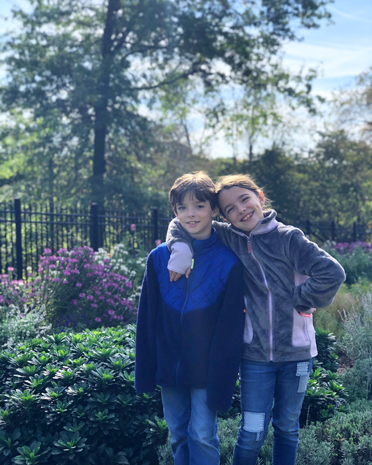 boy girl twins in a garden