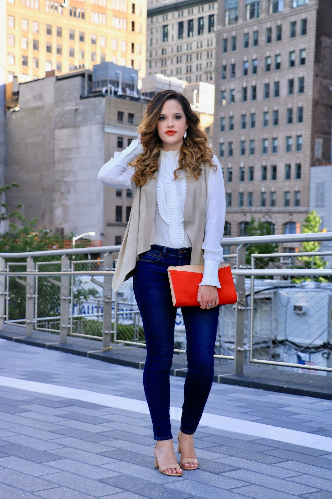 Nyc fashion blogger Kathleen Harper showing how to wear a suede vest
