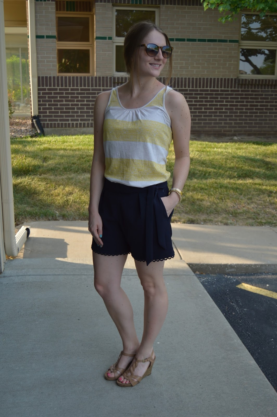 preppy summer outfit | summer outfit ideas | cute outfit ideas for summer | preppy looks for summer | navy shorts | yellow striped tank top | what to wear this summer |