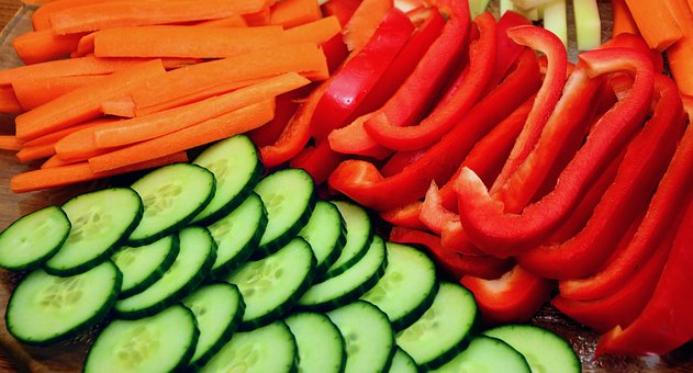 sliced red peppers, cucumbers, and carrots