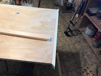 One of the pine boards glued in place - time for the next one