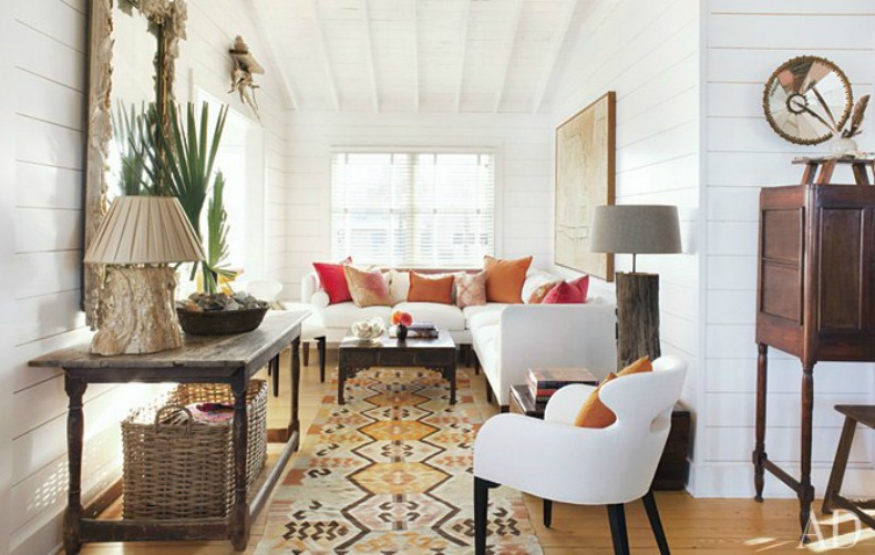 The Living Room has the same eclectic vibe that runs through the beach house, with the white slipcover sectional and Swedish table with mirror.