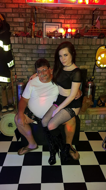 Female stripper sitting on the guest of honor's lap