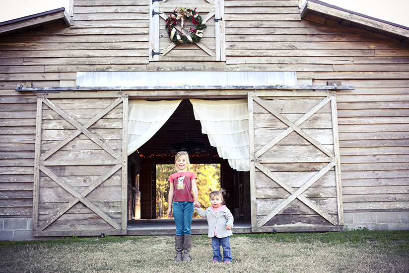 Sisters stand outside the barn at Horse Stamp Inn