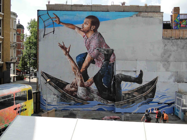 "Fintan Magee's ""Survival Of The Fittest"" Street Art Mural In East London, UK."