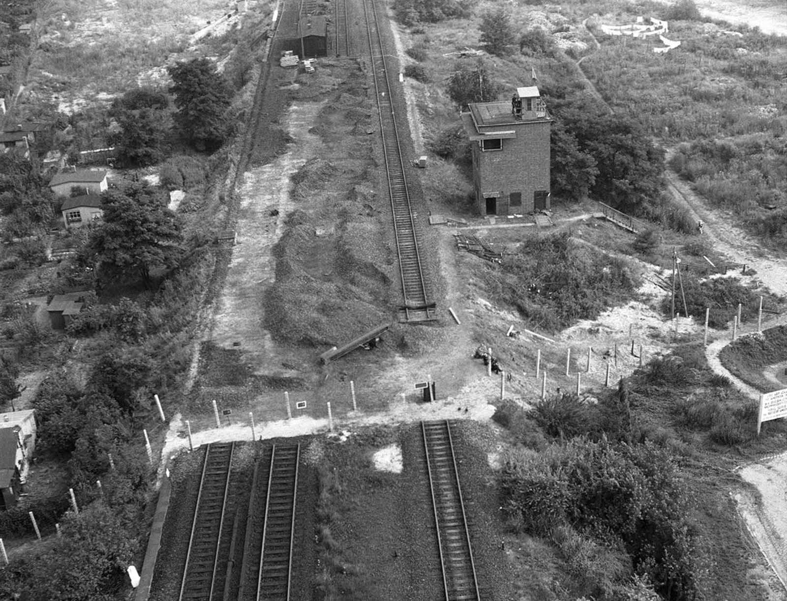 Tracks of the Berlin elevated railroad stop at the border of American sector of Berlin in this air view on August 26, 1961. Beyond the fence, communist-ruled East Berlin side, the tracks have been removed.