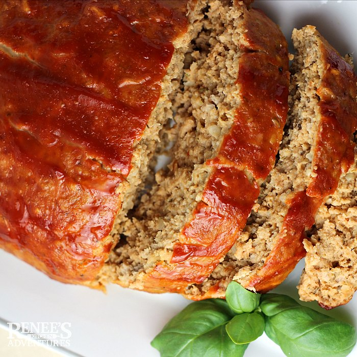 The Best Ground Turkey Meatloaf on platter, sliced from loaf, overhead view