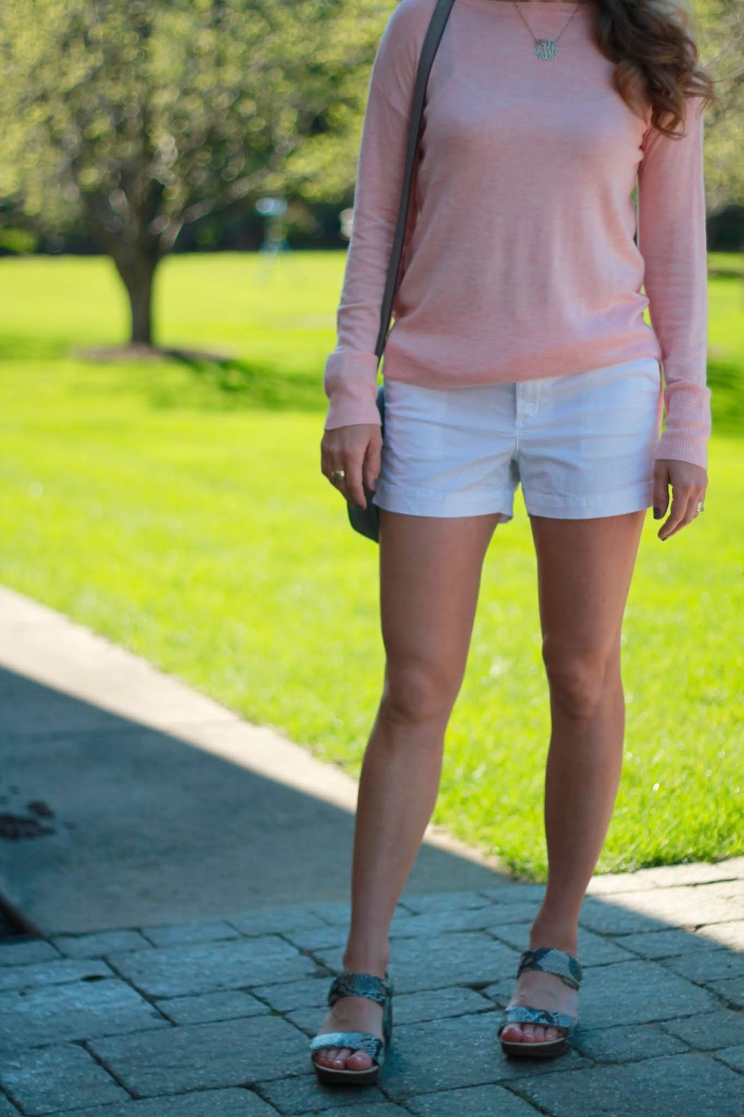 snakeskin wedges, pink sweater, white shorts, grey saddlebag