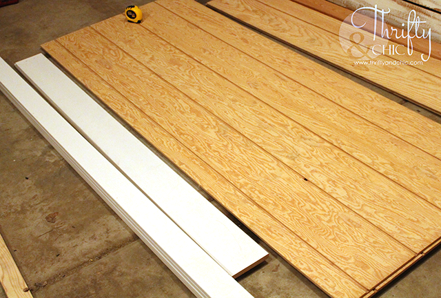 DIY barn door tutorial for sliding double barn doors! Make one of these doors for under $70!