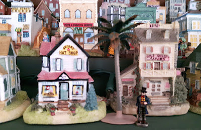 Two buildings from the Liberty Falls collection: Susan's Hat Shop and the Gold Nugget Tavern.