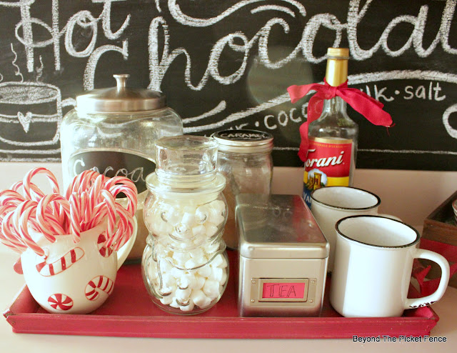 vintage snowman jar hold marshmallows for a hot cocoa station