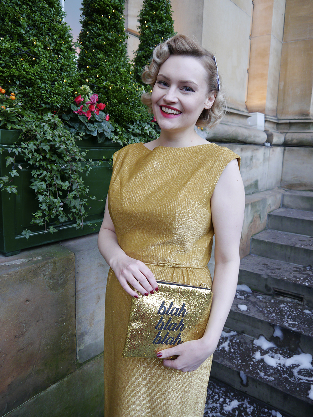 British vintage style blogger, faux fur trimmed Henry Holland coat, gold glitter clutch for christmas party, easy vintage pincurl style with tongs, fashion blogger christmas outfit, gold dress from aprils vintage emporium