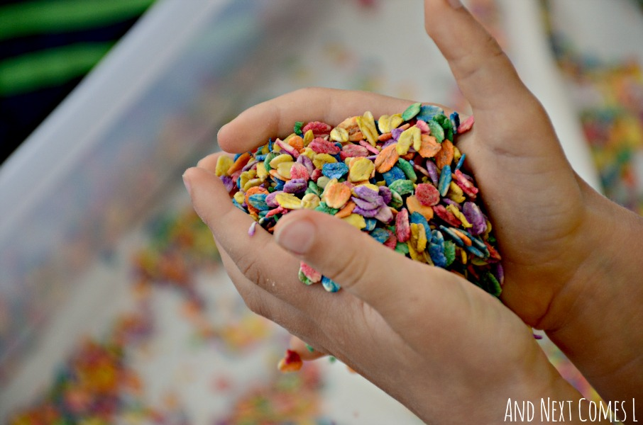 Sensory play with rainbow oats