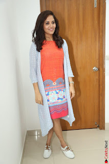 Actress Anasuya Bharadwaj in Orange Short Dress Glam Pics at Winner Movie Press Meet February 2017 (41).JPG