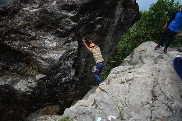 trainees doing chimney climbing at tenzing rock, darjeeling