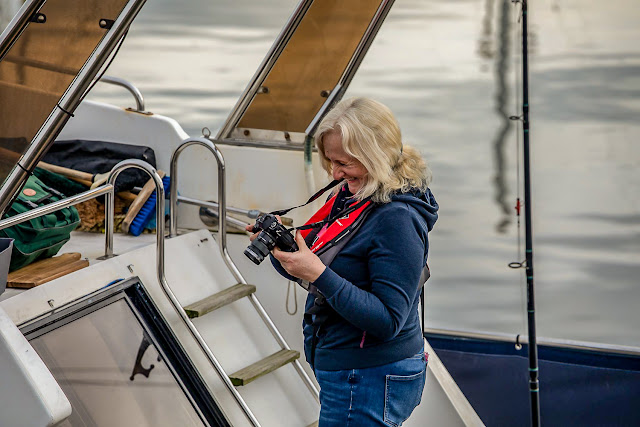 Photo of me checking my camera as we left the marina. Photo by Glyn Jones