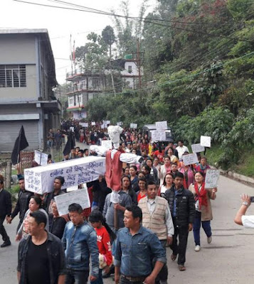 Darjeeling organised a rally  to protest against minister Indranil Sen