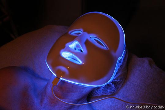 Linda Hall, assistant editor, Hawke's Bay Today, undergoing ionactive power treatment using an LED light therapy mask for skin treatment, at Mia Dolce, Havelock North. photograph