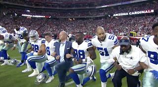Dallas Cowboys, Arizona Cardinals lock arms before Monday Night Football game