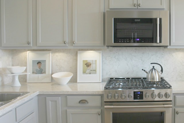 Serene Nordic French kitchen with Soprano quartz countertop and backsplash