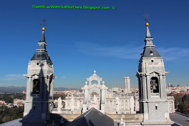 North facing view of the main facade of the cathedral and the Royal Palace, Almudena Cathedral, Madrid, Spain